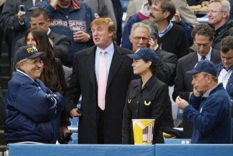 BRONX, NY - OCTOBER 15:  Real estate magnate Donald Trump talks with former New York City mayor Rudy Giuliani while current mayor Michael Bloomberg (far R) eats popcorn before the start of game 6 of the American League Championship Series between the Yankees and Boston Red Sox on October 15, 2003 at Yankee Stadium in the Bronx, New York. (Photo by Ezra Shaw/Getty Images)