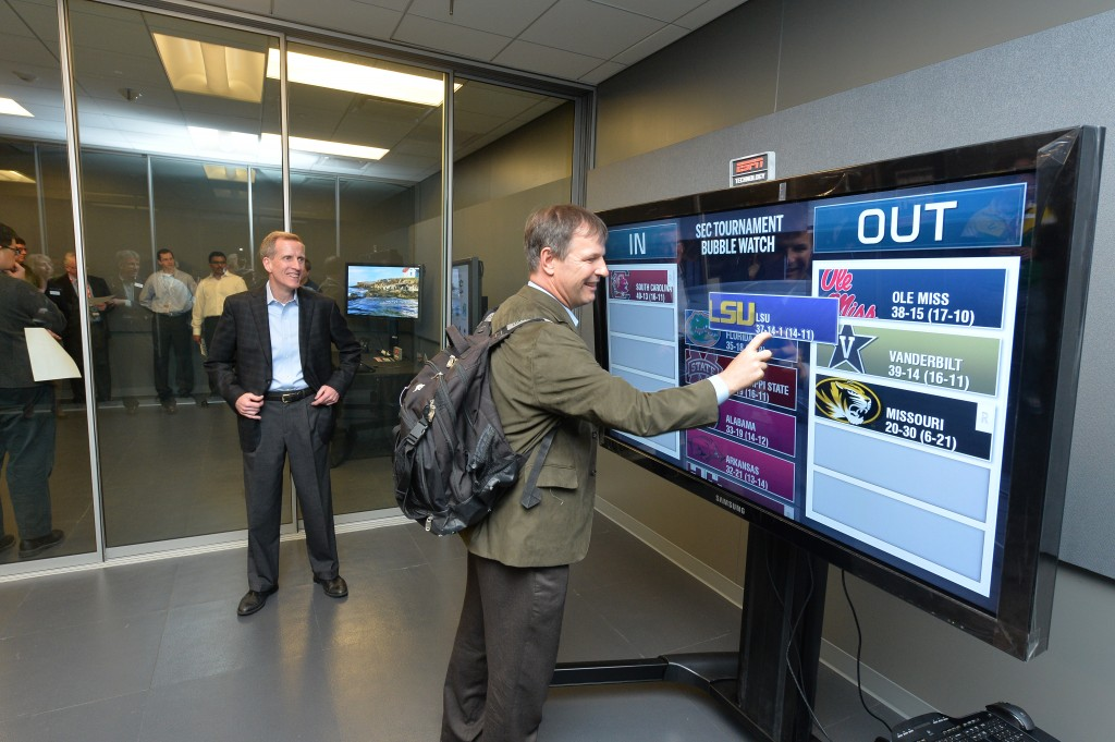 John Ourand of Sports Business Journal learning the new ESPN touchscreens (courtesy ESPN)