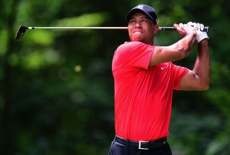 GREENSBORO, NC - AUGUST 23:  Tiger Woods tees off on the second hole during the final round of the Wyndham Championship at Sedgefield Country Club on August 23, 2015 in Greensboro, North Carolina.  (Photo by Jared C. Tilton/Getty Images)