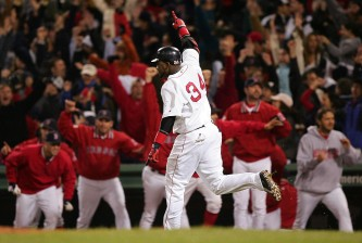 BOSTON - OCTOBER 17:  David Ortiz #34 celebrates after hitting the game winning two-run home run against the New York Yankees in the twelfth inning during game four of the American League Championship Series on October 17, 2004 at Fenway Park in Boston, Massachusetts.  (Photo by Jed Jacobsohn/Getty Images)