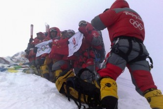 Olympic Flame Summits Mount Everest
