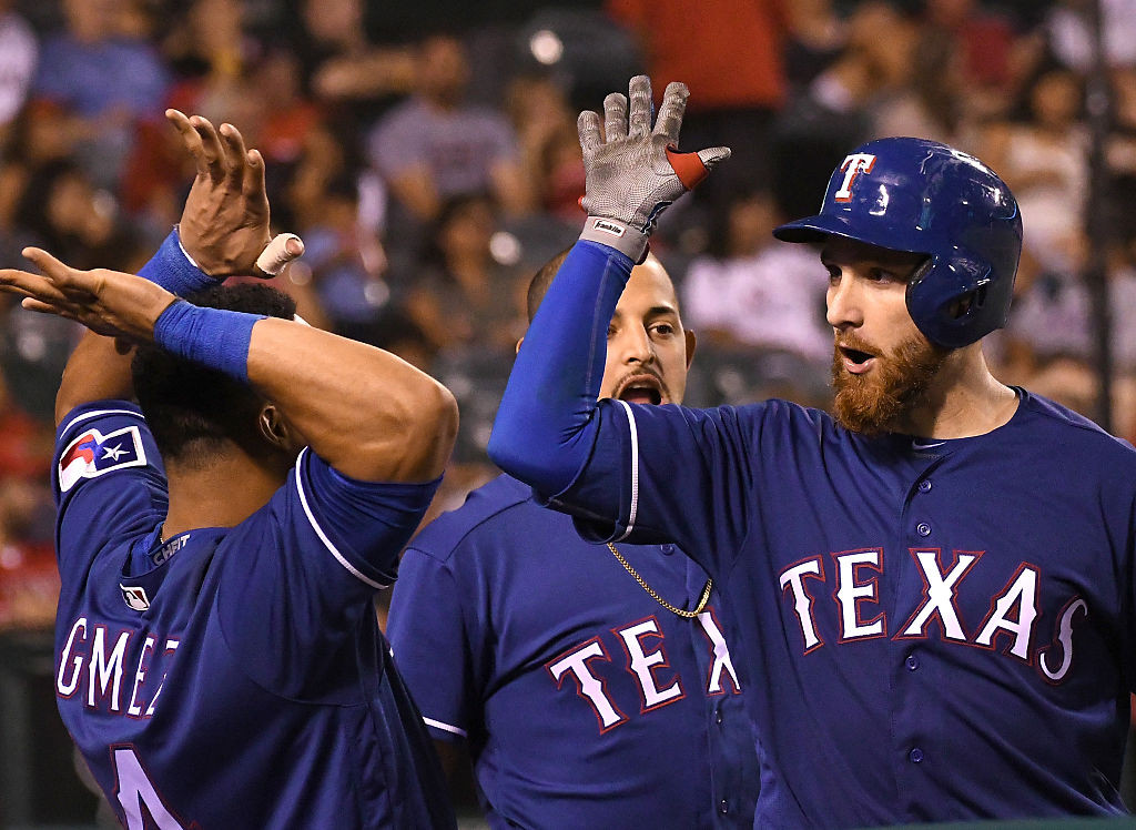 ANAHEIM, CA - SEPTEMBER 10:  Jonathan Lucroy #25 of the Texas Rangers gets high fives from Rougned Odor #12 and Carlos Gomez #14 after a 2 run home run in the eighth inning of the game against the Los Angeles Angels at Angel Stadium of Anaheim on September 10, 2016 in Anaheim, California. (Photo by Jayne Kamin-Oncea/Getty Images)