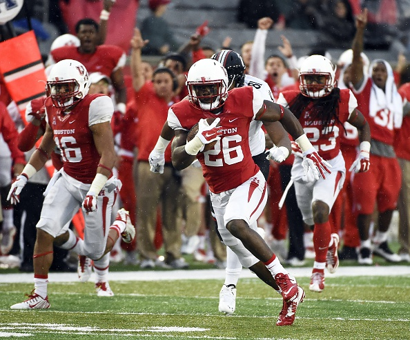 HOUSTON, TX - NOVEMBER 7: Brandon Wilson #26 of the Houston Cougars returns an interception for a 51-yard touchdown in the third quarter of a NCAA football game against the Cincinnati Bearcats at TDECU Stadium on November 7, 2015 in Houston, Texas. (Photo by Eric Christian Smith/Getty Images)
