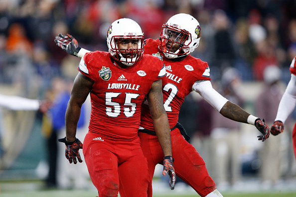 NASHVILLE, TN - DECEMBER 30: Keith Kelsey #55 of the Louisville Cardinals celebrates with Chucky Williams #22 after breaking up a pass against the Texas A&M Aggies in the first half of the Franklin American Mortgage Music City Bowl at Nissan Stadium on December 30, 2015 in Nashville, Tennessee. (Photo by Joe Robbins/Getty Images)