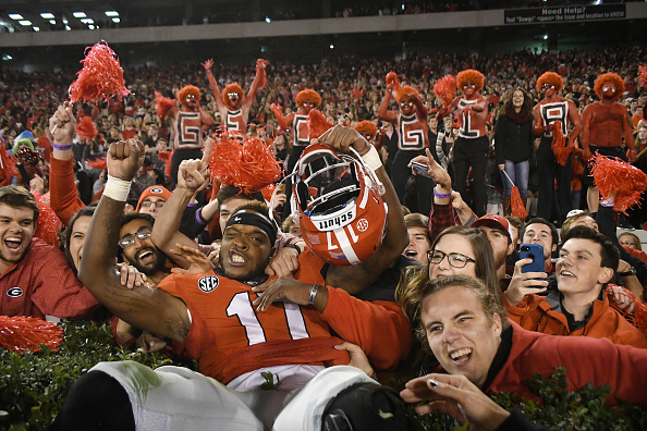 ATHENS, GA - NOVEMBER 12:  Davin Bellamy (17) Georgia Bulldogs linebacker celebrates with fans after the game between the Auburn Tigers and the Georgia Bulldogs on November 12, 2016, at Sanford Stadium at Athens, GA. Georgia defeated Auburn 13-7. (Photo by Jeffrey Vest/Icon Sportswire via Getty Images)