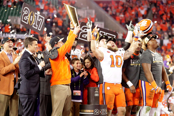 TAMPA, FL - JANUARY 09:  Head coach Dabo Swinney of the Clemson Tigers celebrates with the College Football Playoff National Championship Trophy after defeating the Alabama Crimson Tide 35-31 to win the 2017 College Football Playoff National Championship Game at Raymond James Stadium on January 9, 2017 in Tampa, Florida.  (Photo by Jamie Squire/Getty Images)