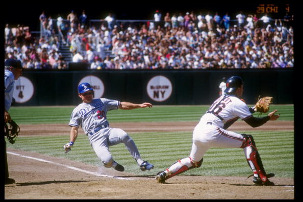 9 May 1993:  Outfielder Mitch Webster of the Los Angeles Dodgers (left) slides into base during a game against the San Francisco Giants at Candlestick Park in San Francisco, California. Mandatory Credit: Otto Greule  /Allsport