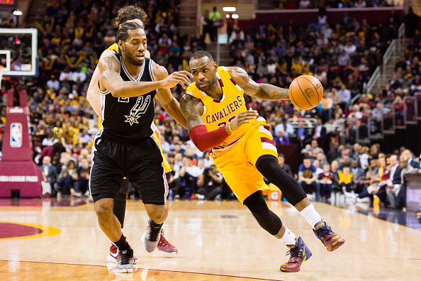 CLEVELAND, OH - JANUARY 30: Kawhi Leonard #2 of the San Antonio Spurs puts pressure on LeBron James #23 of the Cleveland Cavaliers during the first half at Quicken Loans Arena on January 30, 2016 in Cleveland, Ohio. (Photo by Jason Miller/Getty Images)